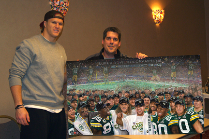 Clay Matthews and artist with Super Bowl team portrait